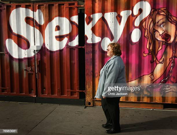 A lady walks past an art installation entitled 'The Journey against Sex Trafficking' in Trafalger Square on September 24 2007 in London England The...