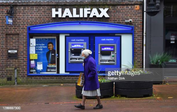 Lady walks pasts Halifax Bank on November 20, 2020 in Newcastle-Under-Lyme, England.