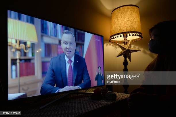 Lady watches a televised address by Polish President Andrzej Duda, just one hour after Mateusz Morawiecki, the Prime Minister of Poland just...