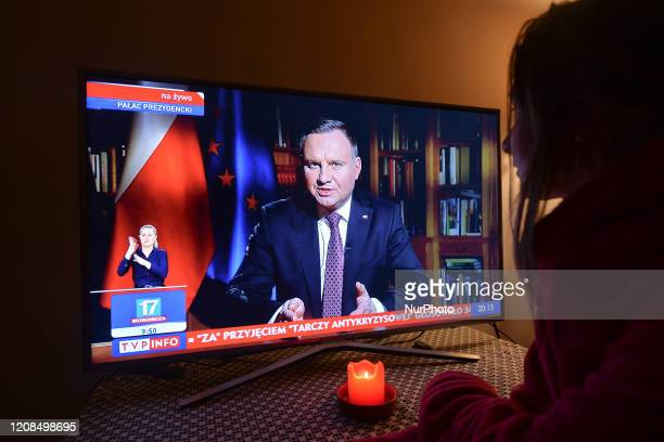 Lady watches a televised address by Polish President Andrzej Duda, during the 8pm National News on TVP1. WIth another 249 new cases of coronavirus in...