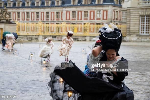 Lady wearing a black tulle dress Louis XIV period courtship party courtyard of the palace of Versailles France Historical reenactment