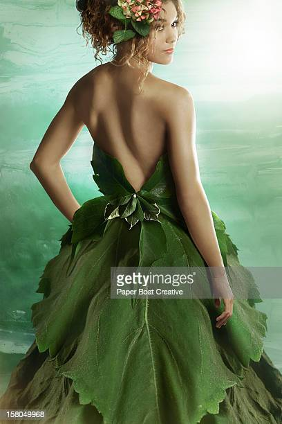 lady wearing a fashionable dress made of leaves - green dress stock pictures, royalty-free photos & images