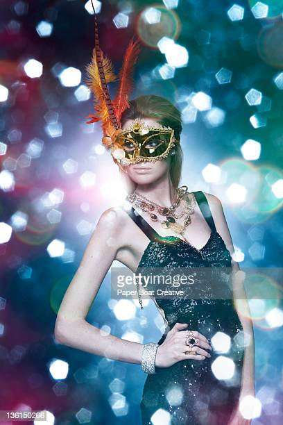 lady wearing a golden feather mask in a party