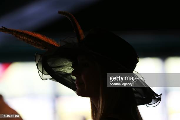 A lady wears a decorated hat during Longines Most Elegant Woman fashion contest on the 149th running of the Belmont Stakes at Belmont Park in Elmont...
