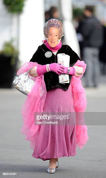 A lady wears a mask of Queen Elizabeth II on ladies day at Aintree racecourse on April 09 2010 in Liverpool England