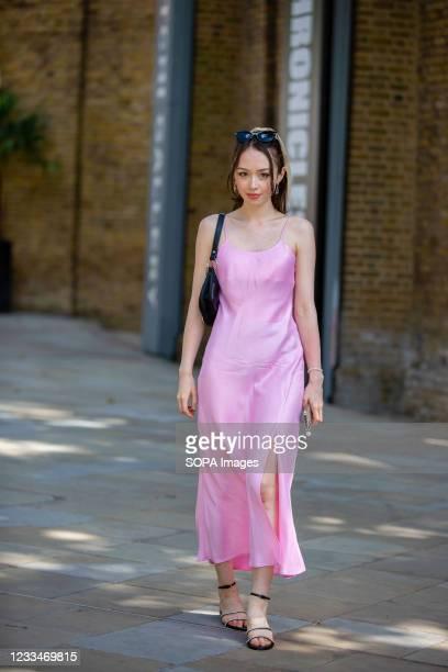Lady wears a Pink Zara dress during the London Fashion Week digital shows in London.