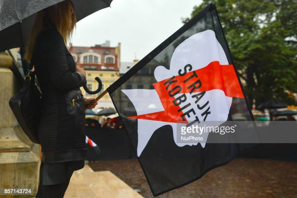 A lady with a banner 'Women Strike' wearing black participate in Black Tuesday protest in Rzeszow Main Square On the first anniversary of Black...