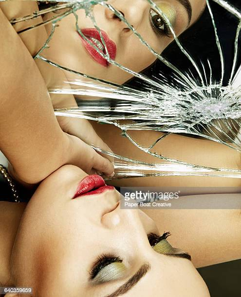lady with a lot of makeup looking at broken mirror - beautiful israeli women stock pictures, royalty-free photos & images