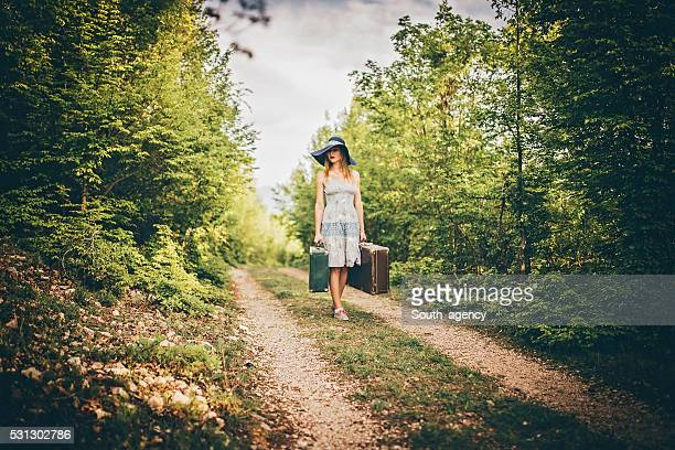 Lady with bags in nature