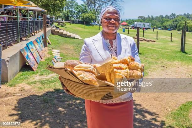 Lady with bread basket at Riversands farm Village in Fourways