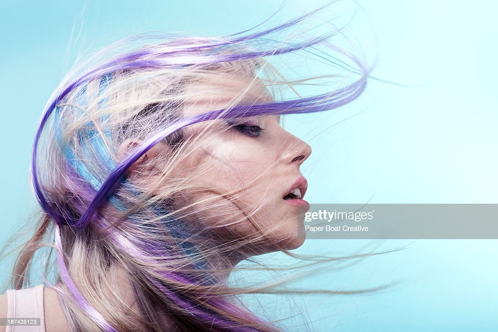 Lady with colorful hair flying over her face : Stock Photo