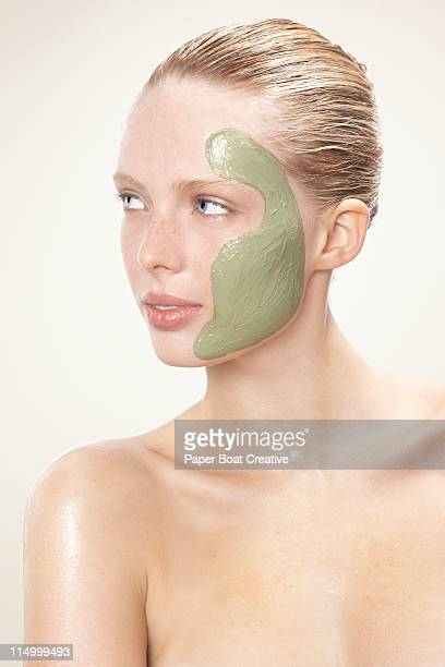 lady with green facial mud mask on her face