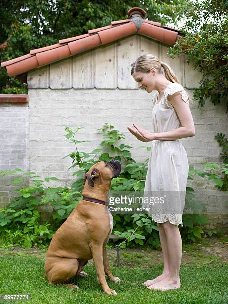 Lady with her Boxer (Canis lupus familiaris)
