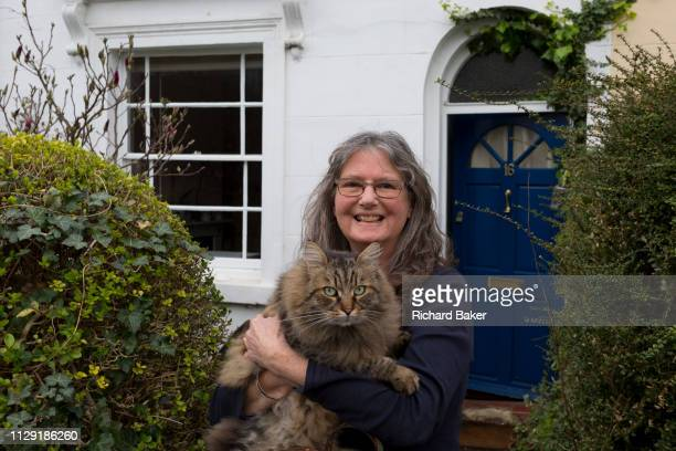 Lady with her cat outside her south London home, on 6th March 2019, in London, England.