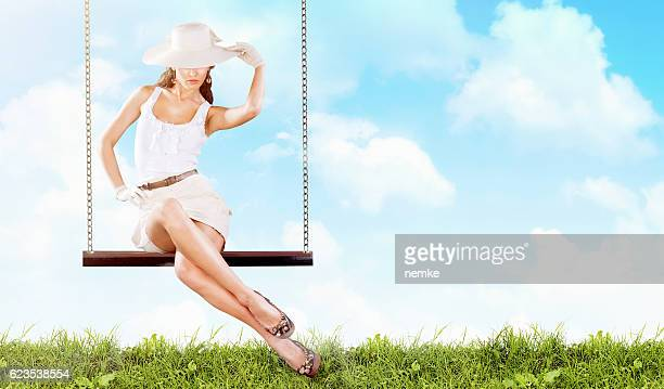 Lady with retro classic outfit on swing