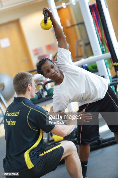 Lady working out with personal trainer