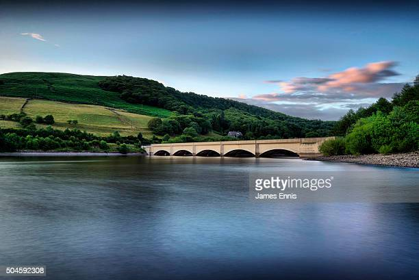 Ladybower Viaduct at Ladybower Reservoir in the Peak District National Park, with Derwent Edge in the background, UK