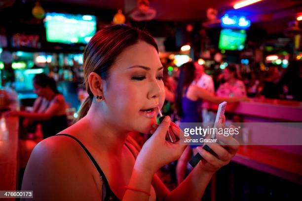 A Ladyboy Prostitute Working For A Brothel In Pattaya City Puts On Make Up As She