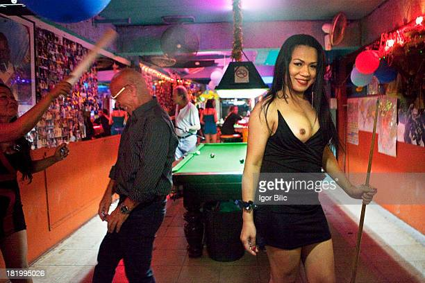 CONTENT] A ladyboy sex worker looking for customers in a bar in Soi Crocodile on Bangla Road Patong Beach Phuket island Thailand Once small fishing...