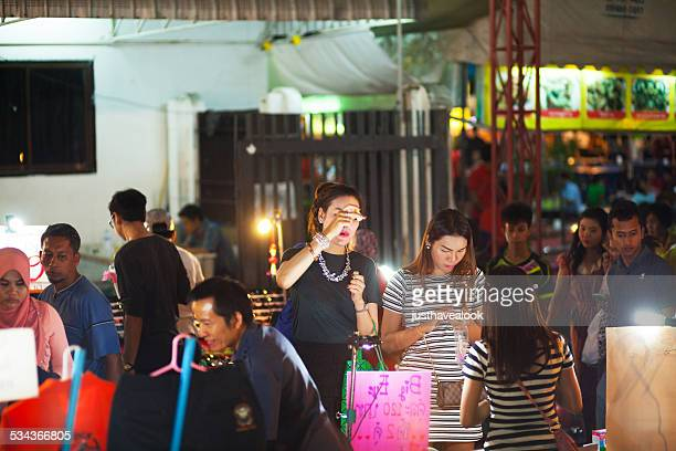 ladyboys checking cosmetics - ladyboys of bangkok stock photos and pictures