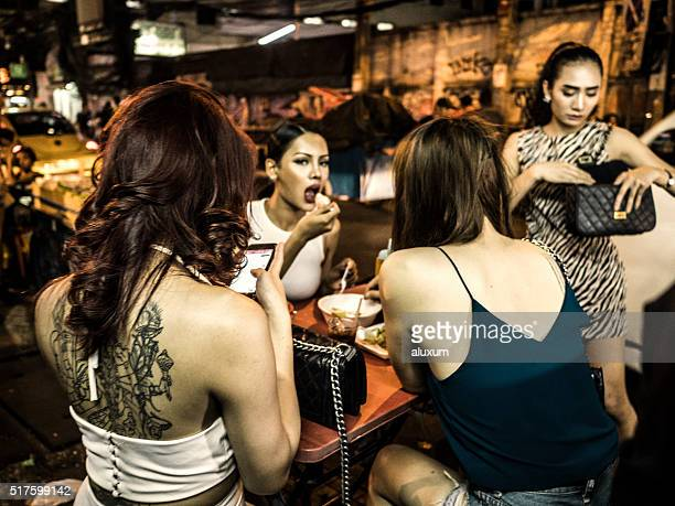 ladyboys in nana plaza red light district bangkok thailand - ladyboys stock pictures, royalty-free photos & images