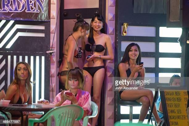 CONTENT] Ladyboys outside a Patpong gogo bar Bangkok Thaiand