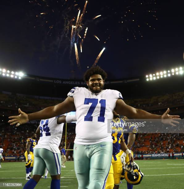 La'el Collins of the Dallas Cowboys is all smiles after the preseason game against the Los Angeles Rams at Aloha Stadium on August 17 2019 in...