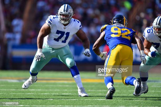 La'el Collins of the Dallas Cowboys pass blocks during the first half of a preseason game against the Los Angeles Rams at Aloha Stadium on August 17...