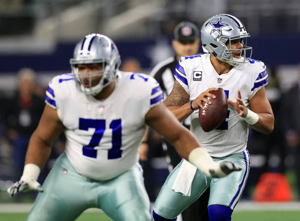 La'el Collins of the Dallas Cowboys protects Dak Prescott of the Dallas Cowboys who looks to pass int he first quarter of a football game against the...