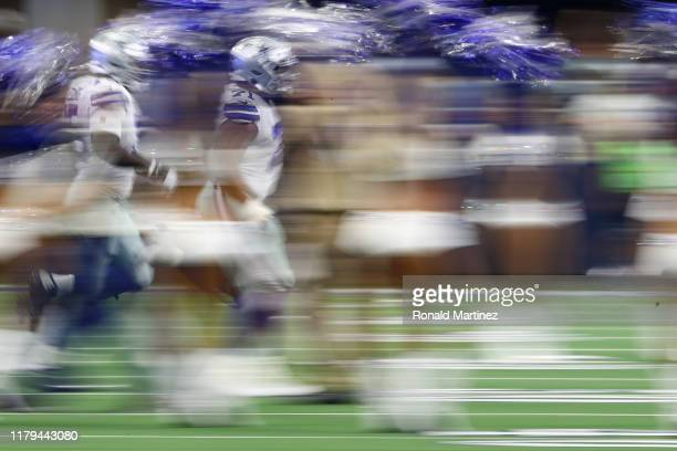 La'el Collins of the Dallas Cowboys runs on the field prior to their game against the Green Bay Packers at ATT Stadium on October 06 2019 in...