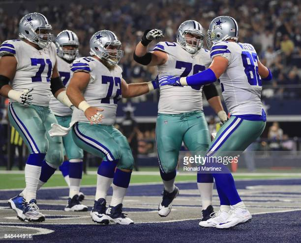La'el Collins of the Dallas Cowboys Travis Frederick of the Dallas Cowboys and Zack Martin of the Dallas Cowboys celebrate the touchdown by Jason...