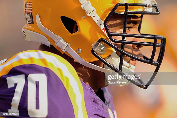 La'el Collins of the LSU Tigers participates in pregame warmups prior to a game against the Kent State Golden Flashes at Tiger Stadium on September...