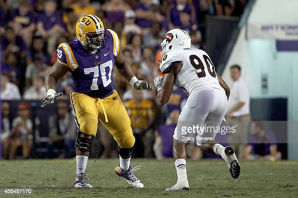 La'el Collins of the LSU Tigers works against Ray Stovall of the Louisiana Monroe Warhawks during the third quarter of a game at Tiger Stadium on...