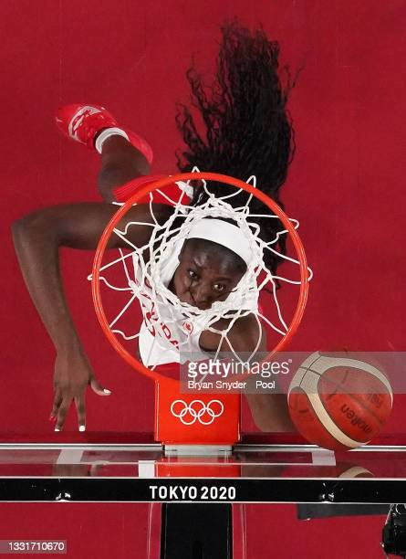 Laeticia Amihere of Team Canada goes up for a shot against Spain during the second half of a Women's Basketball Preliminary Round Group A game at...