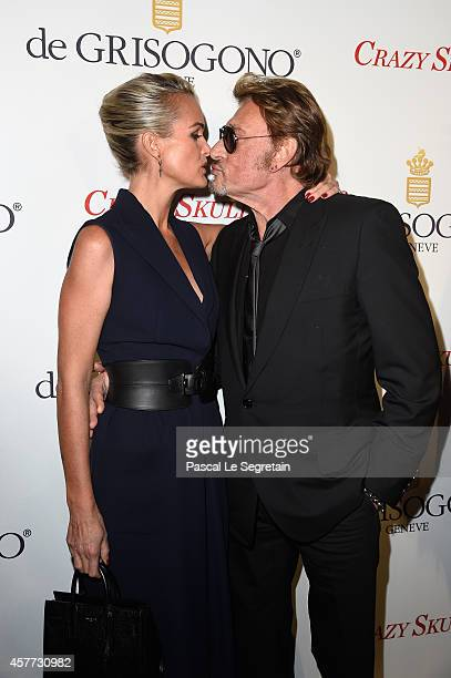 Laeticia and Johnny Hallyday attend the launch of the De Grisogono Crazy Skull watch on October 23 2014 in Paris France