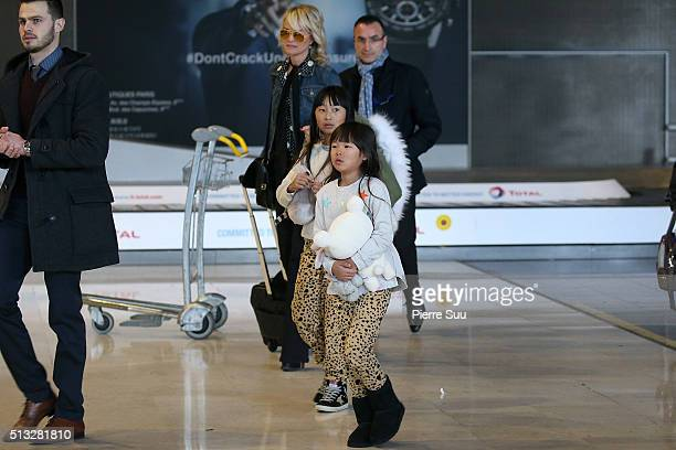 Laeticia Hallyday and her daughters Joy and Jade arrive at Paris Charles de Gaulle airport on March 2 2016 in Paris France