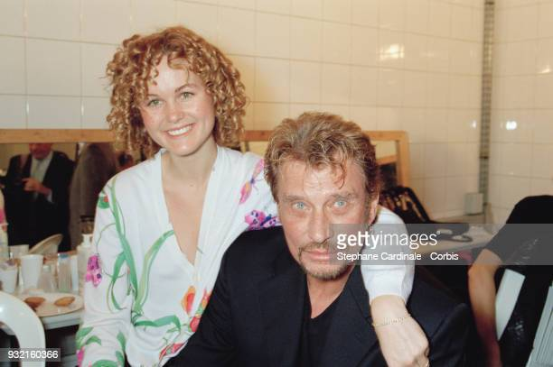 Laeticia Hallyday and her husband Johnny Hallyday posing backstage, Paris, 19th October 1997