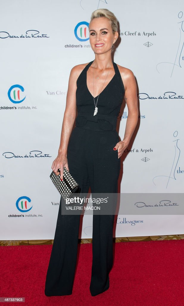Laeticia Hallyday arrives at the The Colleagues 26th Annual Spring Luncheon to Honnor her Serene Highness, Princess Charlene of Monaco in Beverly Hills, California April 29, 2014. Jason Merritt/Getty Images/AFP /
