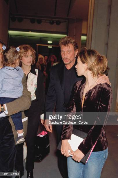 Laeticia Hallyday arriving at the fashion show with her sister Margaux Thibaut her husband Johnny Hallyday and his daughter Laura Smet Paris 19th...