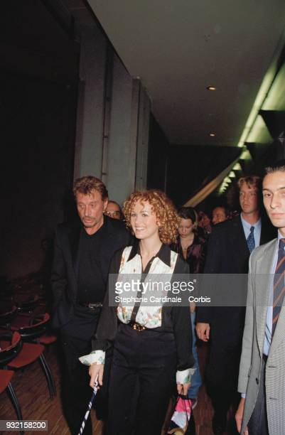 Laeticia Hallyday her husband Johnny Hallyday and Laura Smet arriving at the fashion show Paris 19th October 1997