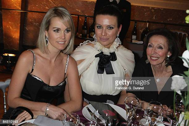Laeticia Hallyday Princesse Kasia Al Thani and a guest attend the international evening of the child on December 9 2008 in Versailles France