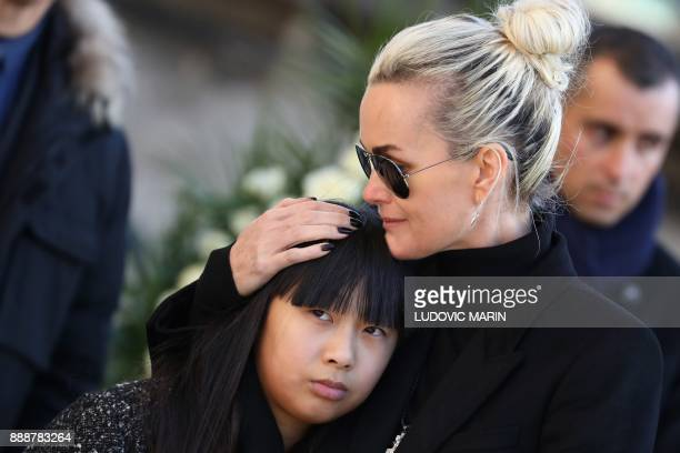 Laeticia Hallyday wife of late French singer Johnny Hallyday and her daughter Jade stand by the coffin outside the La Madeleine Church prior to the...