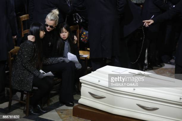 Laeticia Hallyday wife of late French singer Johnny Hallyday her children Jade and Joy sit next to the coffin during the funeral ceremony for Johnny...