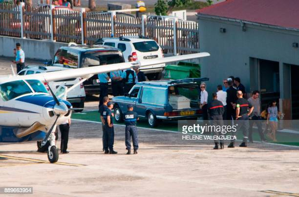 Laeticia Hallyday wife of late French singer Johnny Hallyday stands by a hearse containing the coffin of late French musician Johnny Hallyday after...