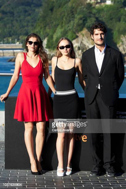 Laetitia Casta Louis Garrel and LilyRose Depp attend 'L'Homme Fidele' Photocall at Aquarium on September 22 2018 in San Sebastian Spain