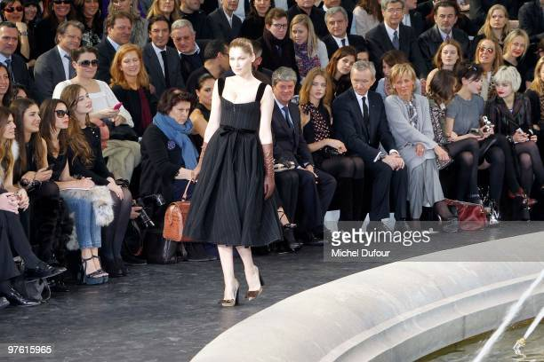 Laetitia Casta walks the runway during the Louis Vuitton Ready to Wear show as part of the Paris Womenswear Fashion Week Fall/Winter 2011 at Cour...