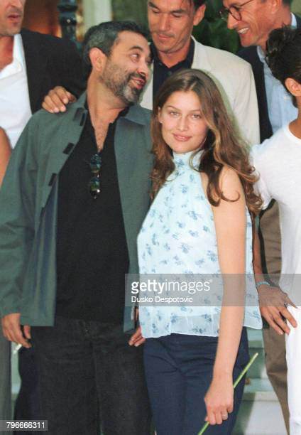 Laetitia Casta with the director of the film 'Gitano' behind them is producer Manuel Lorenzo and scriptwriter Arturo Perez Reverte