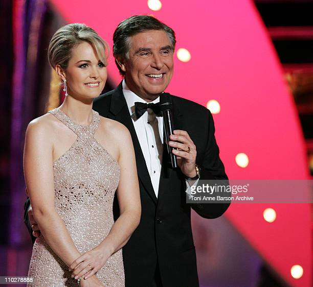 Laetitia Hallyday and Host JeanPierre Foucault during Miss France 2006 Pageant at Palais des Festivals in Cannes France