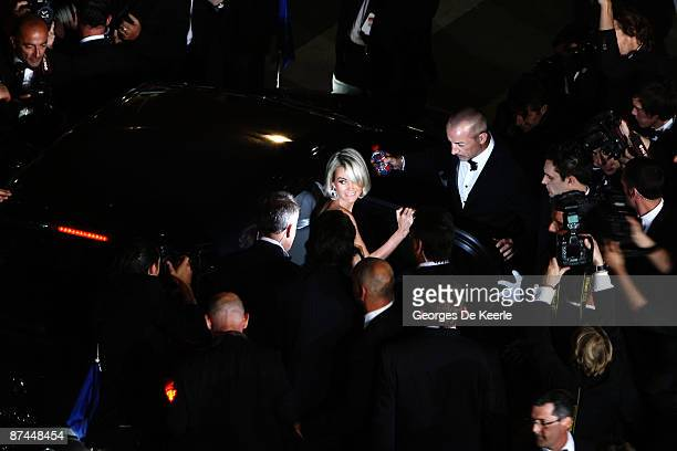 Laetitia Hallyday climbs into a car while departing from the Vengeance Premiere at the Palais Des Festivals during the 62nd International Cannes Film...
