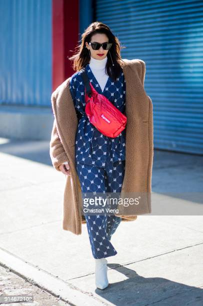 Laetitia Nimah Kutob wearing Max Mara coat Supreme x Louis Vuitton belt bag denim jacket and pants white ankle boots white turtleneck seen during...